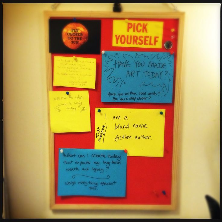 My pinboard by my desk with quotes to keep me writing, and a little Japanese netsuke on the top. Includes 'pick yourself', and have you made art today!