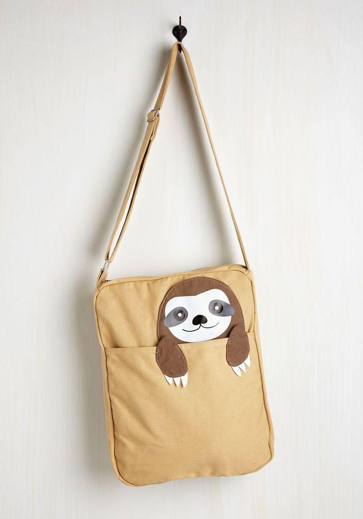 Got One Friend in My Pocket Bag in Sloth. Keep your favorite critter pal nearby with this canvas messenger bag. #tan #modcloth