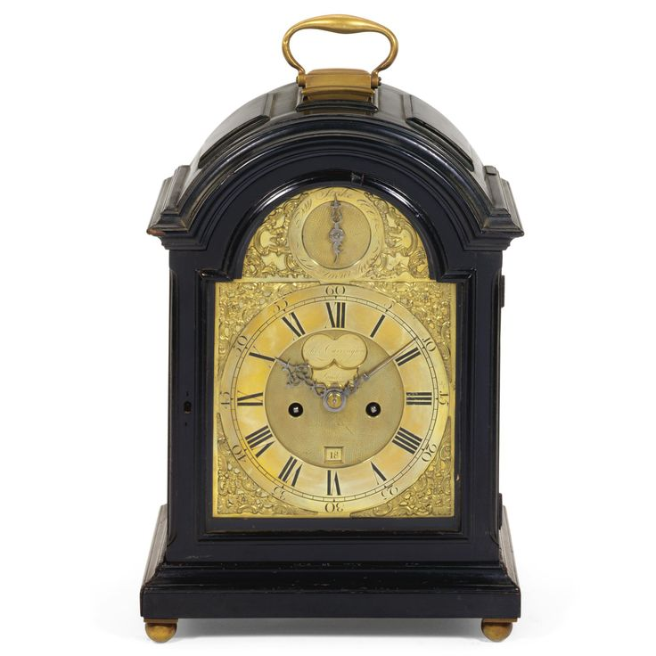 An ebonised table clock, William Post, London, circa 1770 7-inch dial with rococo spandrels, matted centre with calendar and mock pendulum apertures and signed William Post, London on a silvered recessed plaque, the arch with a strike/silent dial, two train bell striking and trip repeating fusee movement with five pillars and verge escapement, the backplate engraved with foliate scrolls, inverted bell top case with brass carrying handle, pineapple finials, scale side frets, rococo door frets…
