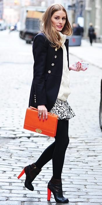 The street style star donned a chunky sweater with a printed skirt and dark peacoat, which she offset with a bold clutch and pop-of-color heels.