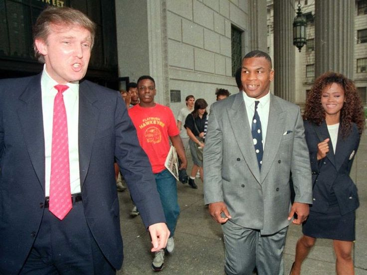 Heavyweight Champion, Mike Tyson, his wife, actress Robin Givens and Donald Trump, leave the New  York State Supreme court building on July 22, 1988.
