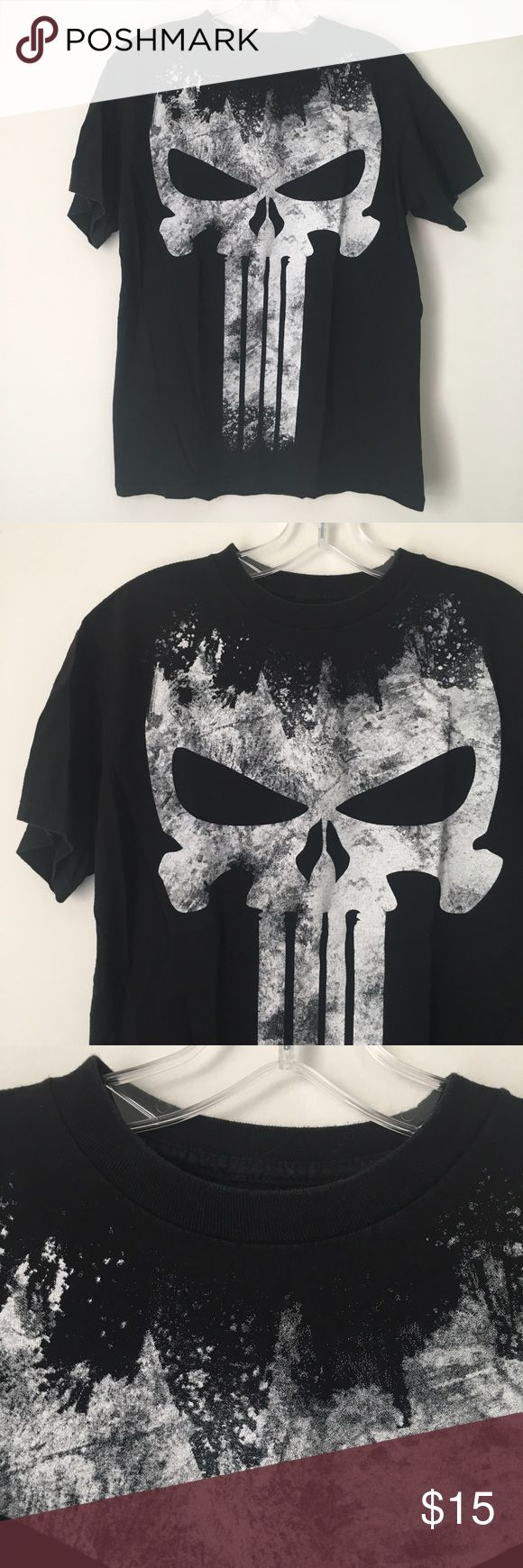 """BLACK GOTH MARVEL PUNISHER SKULL TEE SHIRT TOP !! Black White Graffiti Spray Paint Splatter Goth Gothic Punk Rock Grunge Marvel Punisher Skull Skulls Distressed Faded Tee Shirt Top    Worn and washed a few times, but still in great condition.    NO major or damaging flaws. Minimal fading around the neckline/collar. Clean and excellent otherwise!    Size: Unisex / Adult Medium. (May run a bit smaller.)    Chest (pit to pit) - 18"""" across • Length (shoulder to bottom hem) - 26"""" long    NO…"""