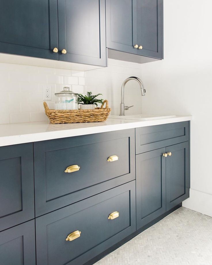 bm hale navy, pure white caesarstone countertops, brass hardware Studio McGee Photography •