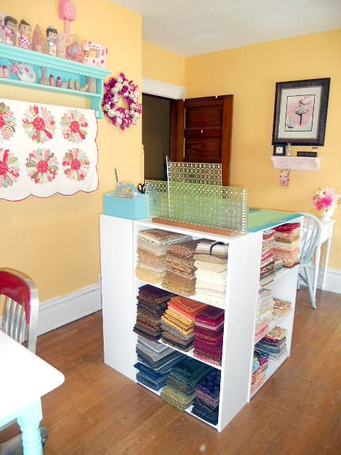 great idea for a cutting table~!4 small bookcases arranged into a square!