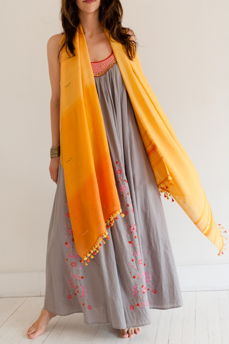 The soft and luxurious Aruna shawl representing a sunrise in the desert.  LOVE the dress too!