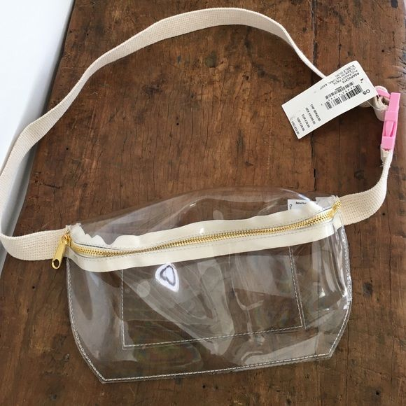 American apparel clear fanny pack bag 90s pink American apparel clear plastic fanny pack. Super cute 90s style for a music festival! Has off white canvas strap with pink buckle and gold zipper. Never worn, original tag attached. American Apparel Bags Mini Bags