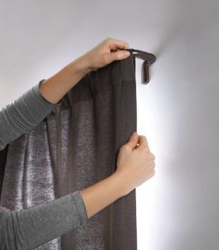 Room darkening curtain rod-holds curtains flat against the wall.