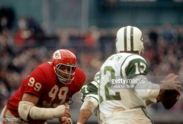 Ernie Ladd of the Kansas City Chiefs rushes quarterback Joe Namath of the New York Jets during an NFL football game at Kansas City Municipal Stadium...