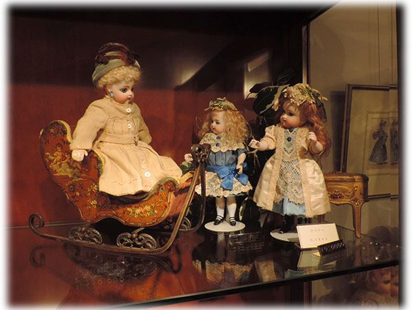 Antique dolls for sale displayed well