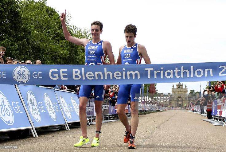 Alistair Brownlee (L) and Jonathan Brownlee (R) of Great Britain cross the finish line during the GE Blenheim Triathlon at Blenheim Palace on June 9, 2012 in Woodstock, England.