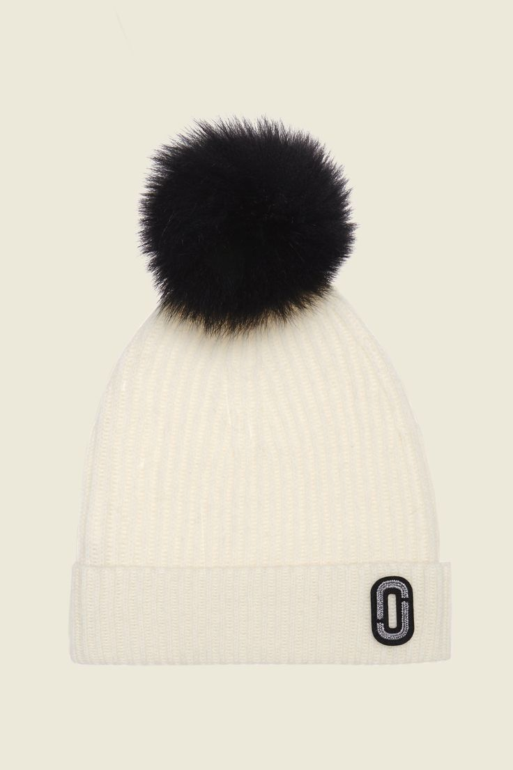"Stay cozy during the cold weather months with this classic cashmere beanie. Features our double ""J"" logo for a traditional MJ look and a fuzzy pompom for a playful accent.buFeatures/b/u•Cashmere•1 size"