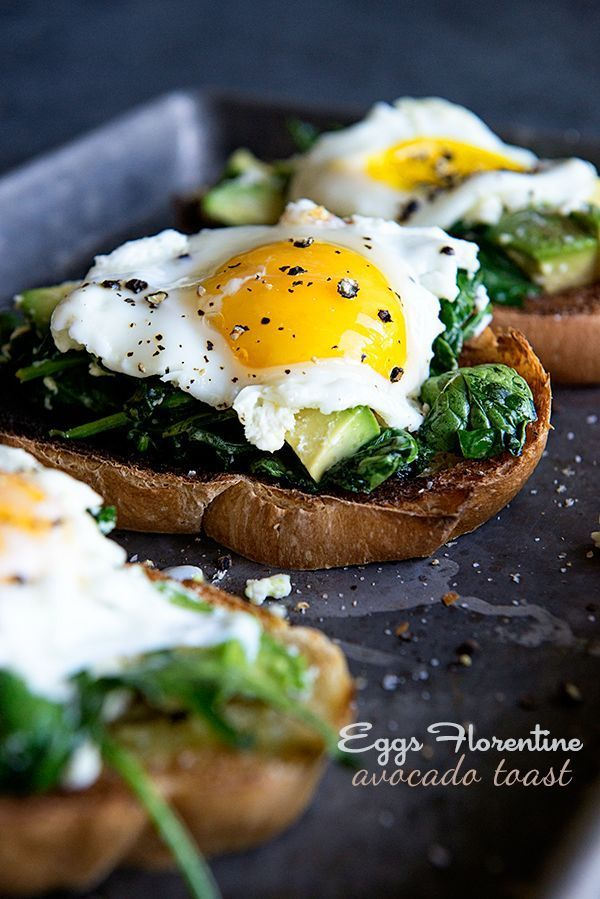 Eggs Florentine Avocado Toast is a great breakfast or brunch recipe featuring goat cheese and creamy California Avocados. (Breakfast Eggs)