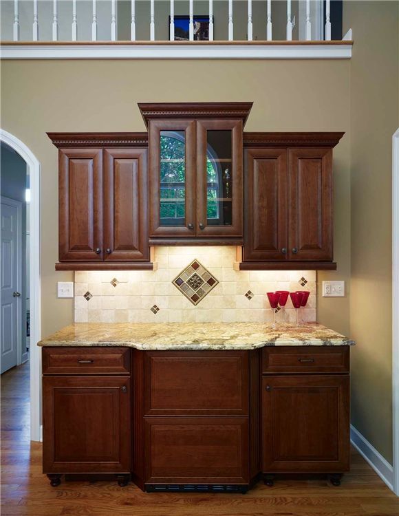 Kitchen---envisioning something sort of like this for wine/coffee bar--more straight lined, smaller if any cabinetry but like underlighting effect