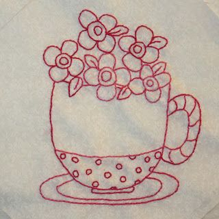 Cozy Afternoon FREE Block of the Month quilt pattern. Block #1, teacup block. Block made and embroidered by Kathy's Quilts. BOM designed by Jacquelynne Steves.