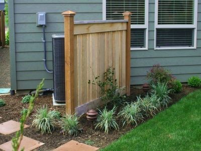 Privacy fence to hide air conditioning units.