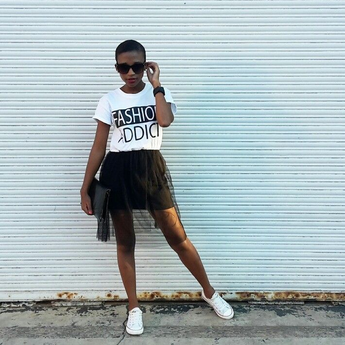 black tulle skirt, statement t-shirt and sneakers