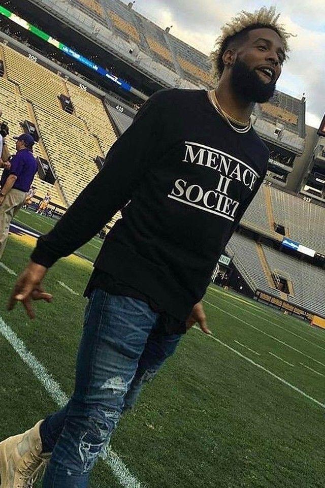 Odell Beckham Jr. wearing  Supreme Menace II Society , Amiri Patchwork MX1 Jeans, Yeezy Season 3 Military Boot
