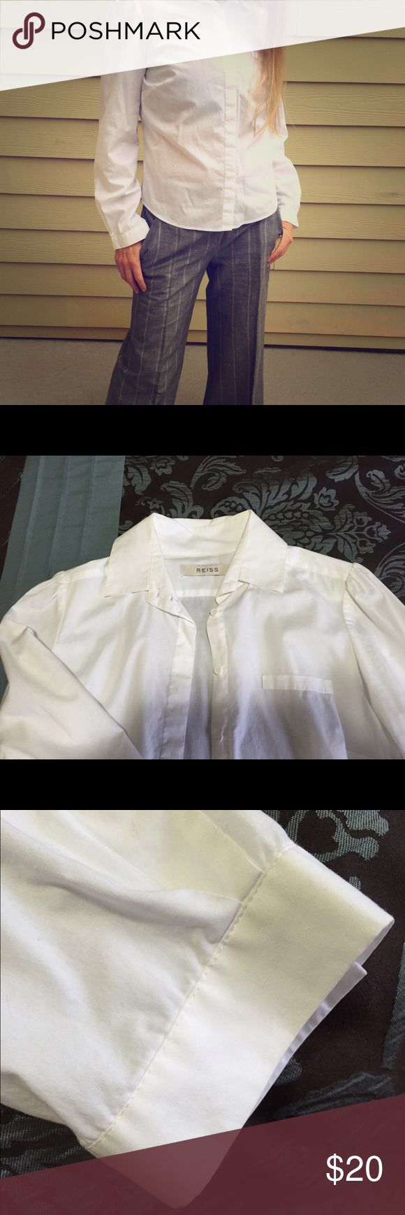 Reiss (UK designer brand) white blouse Gorgeous blouse with the slight puffy shoulders and real simple cuffs.  Great for the office or to dress up jeans! Reiss Tops Blouses
