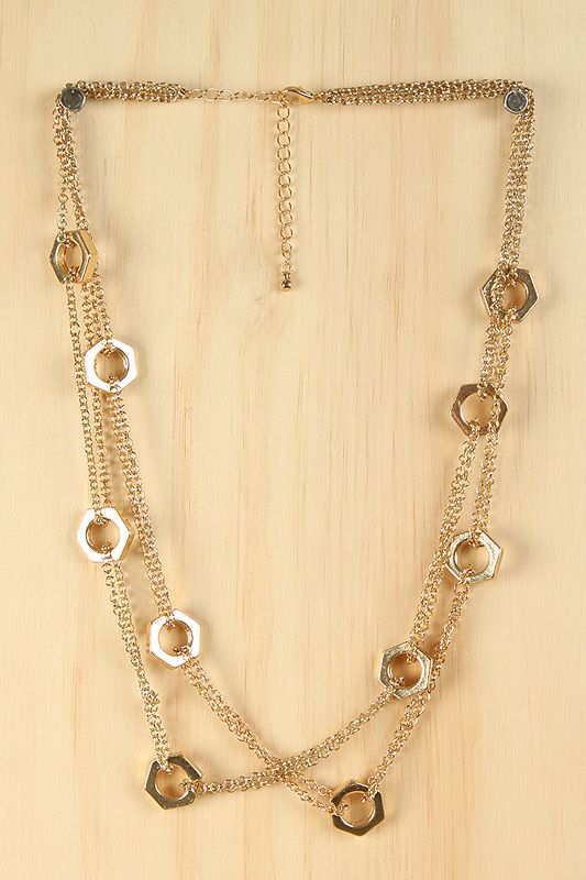 Hardware Necklace. Loop different lengths of jewelry chair around hex nuts. This necklace has 10 and has a lobster clasp.