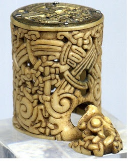 Pradzieje Pomorza: Viking ivory carving ~ Spirals representing birth, death and rebirth and and lots of knots that may be a reference for use when sailing; or it may represent the labyrith. The separate small piece has a raven, which figures significantly in the Viking culture.