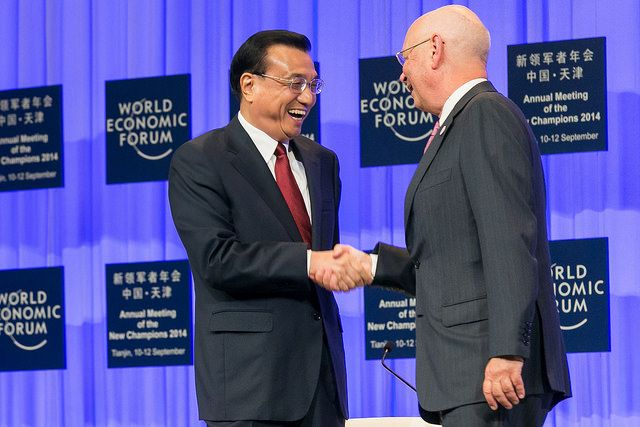 Li Keqiang, Premier of the People's Republic of China and Klaus Schwab, Founder and Executive Chairman, World Economic Forum at the World Economic Forum #amnc14 Annual Meeting of the New Champions in Tianjin, People's Republic of China 2014. Copyright by World Economic Forum / Benedikt von Loebell