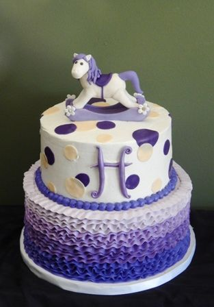 "2 tier purple theme baby shower cake. bottom tier frosting ombre ruffles. top tier frosting covered with fondant ""H"" and dots. Handmade gumpaste rocking horse"