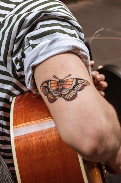 Arguably, this is the best photo I took of his tattoo. This image will be included in my final series. I really enjoy my framing of this and the similarity of the orange tonnes between the guitar and the moth.
