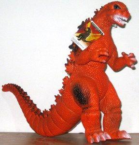 Juguete de Godzilla fusión nuclear. Diseño color naranjo - portal #Ñoño .-.-.-.-.-.-.-.-.-.-.-.-  -.-.-.-.-.-.-.-.-.-.-.-.-.-.-.-.-.-   Godzilla fusión nuclear. Figura plástica con el diseño clásico pero color naranjo. Mueve piernas y brazos. Mide 30 x 30 cms. Empaque: bolsa.