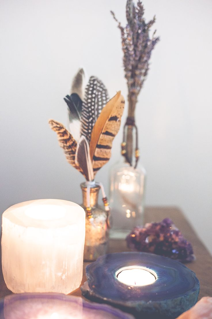 Crystal candles with feathers and lavender sprigs in vases - fun Boho centerpiece idea
