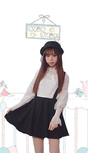 Flouncy two piece outfit with black brace skirt and blouse