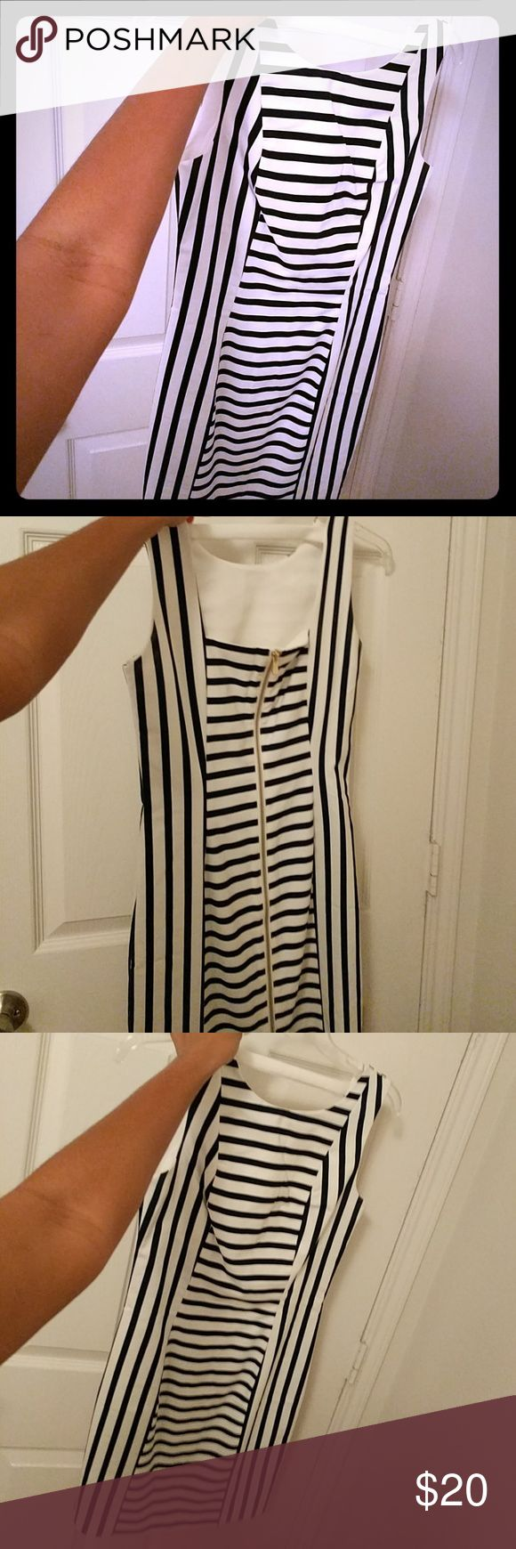 Navy blue and white cocktail dress Gold zip-up in the back. Great for parties and formal events. Best paired with a blazer. Worn once. H&M Dresses Midi