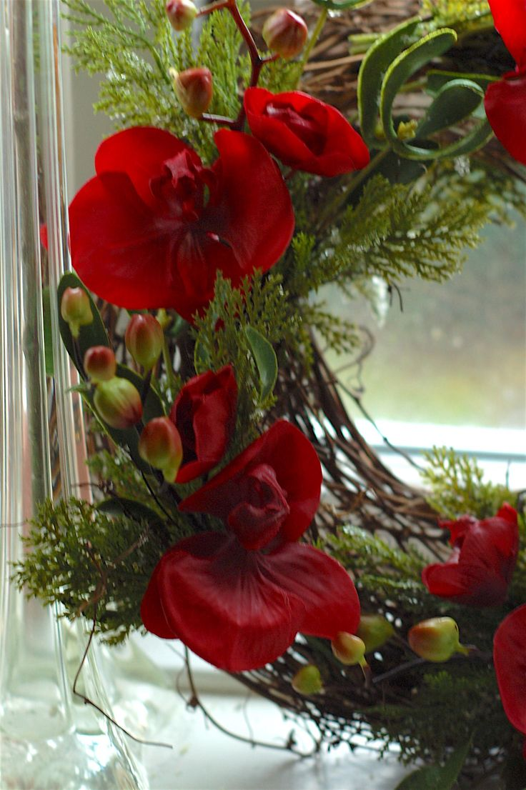 Rustic twig wreath with cypress pine, mistletoe and beautiful red orchids. Made to last!.