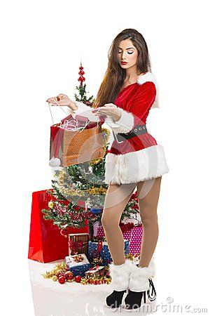 Attractive sensual young lady dressed in sexy Santa outfit opening a present bag near decorated Christmas tree and gifts, on white. Download Christmas Joy Royalty Free Stock Photography for free or as low as 0.69 lei. New users enjoy 60% OFF. 20,057,919 high-resolution stock photos and vector illustrations. Image: 35553857