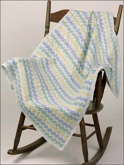 Free Zigzag Shells Baby Afghan Crochet Pattern --  Download this free crochet baby blanket pattern from Freepatterns.com.