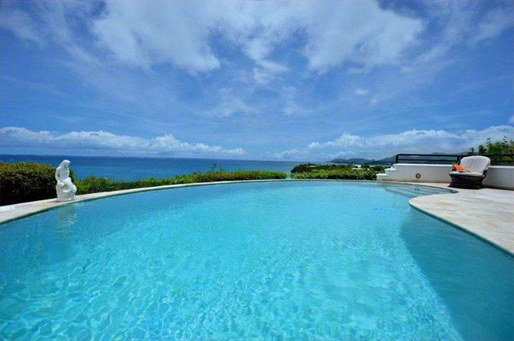 AQUARELLE http://www.stmaarteninvestments.com/real-estate.aspx?id_villa=45&type=sale&utm_source=Pinterest&utm_medium=Pinterest&utm_campaign=magic+bullet Nestled above the Caribbean, this St. Martin, villa offers stunning views in a magnificent setting.  Each of the 4 BRs has a private bath, A/C and ceiling fan. Fully equipped large kitchen, top-flight entertainment center throughout the villa. Whether lounging by the pool or on the shady terrace, enjoying the jasmine-scented sea breeze…