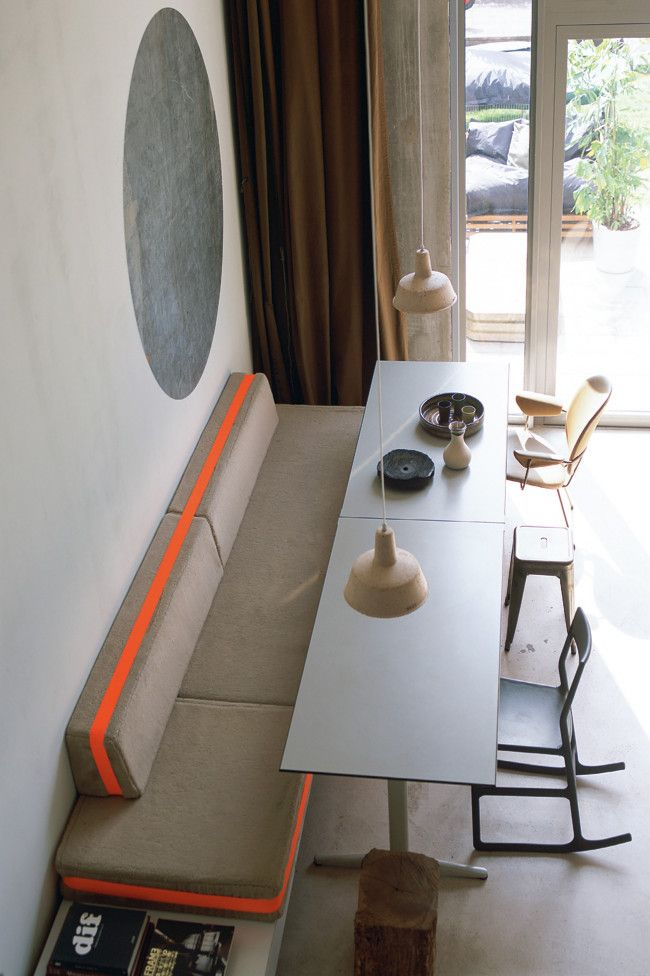 a little electric accent/sporty stripe on some of the banquette cushions?