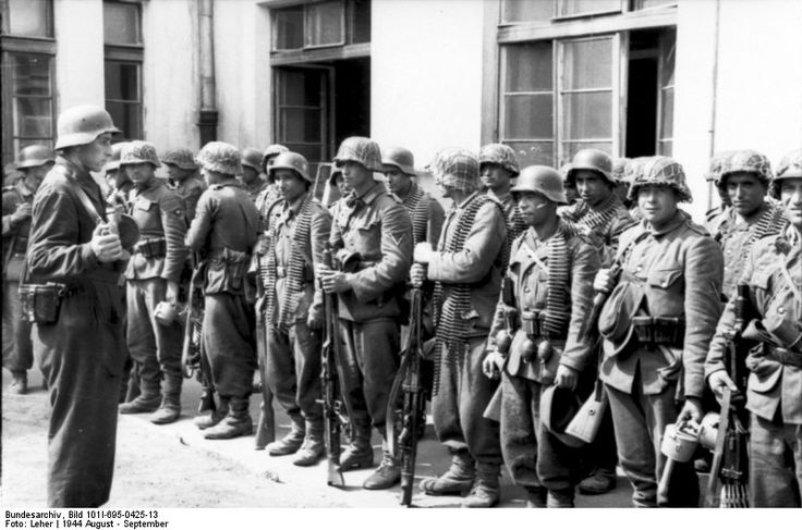 The Nazi used multi-ethnic forces in battle. SS forces contained Russians, Ukrainians, Cossacks, Norwegians and Azeri as seen here. There were also Azeri fighting on the Polish side. - Huge Collection Of The Warsaw Uprising Photos 18  Best of Web Shrine