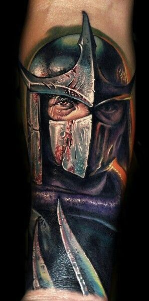 This badass Shredder tattoo was inked by Roman Abrego.