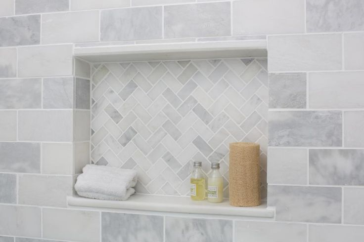 cubby with coordinating tile and marble shelf (no icky grout on the horizontal surface then). i'd do two.