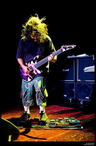 Stephen Carpenter of Deftones. Nothing says badass like a pink and purple camo guitar!