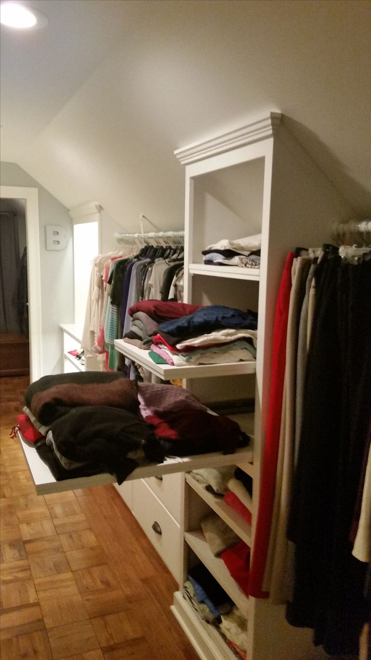 Custom Walk-in Closet, slanted ceilings...double-deep full extension shelves.