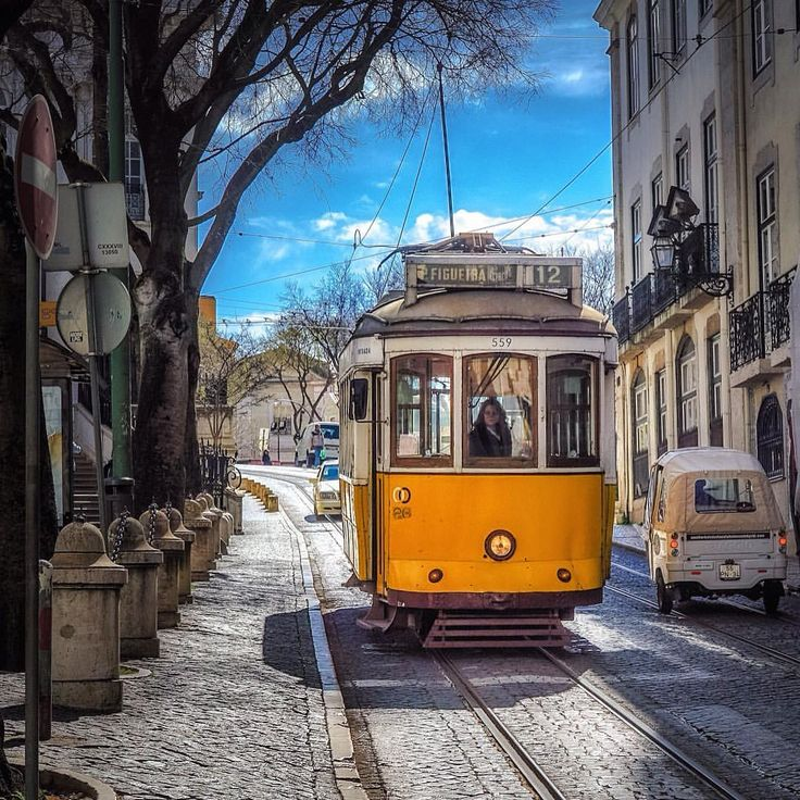 "Yellow objects fascinate me. As a kid we used to play ""yellow car"". You know the game? Lisbon's iconic and colorful trams. Lisbon re-latergram"
