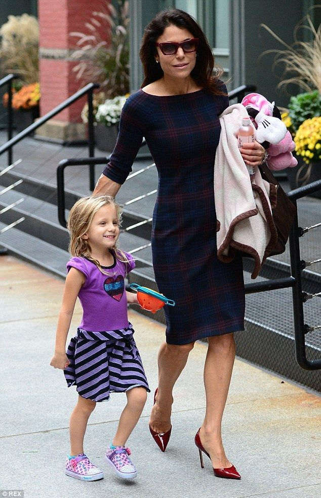 She means business: Bethenny Frankel was professionally dressed in a conservative navy pla...