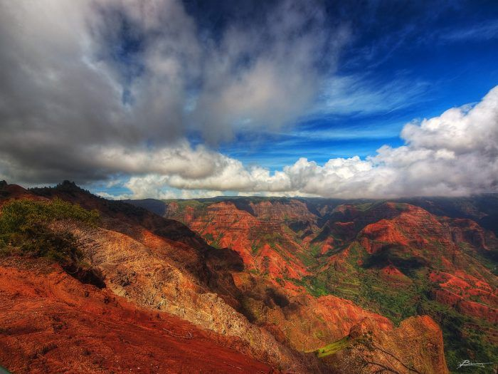With brilliant shades of red, brown, green, blue, gray and purple, Waimea Canyon State Park encompasses approximately 1,866 acres, and is one of the island's most popular tourist destinations.