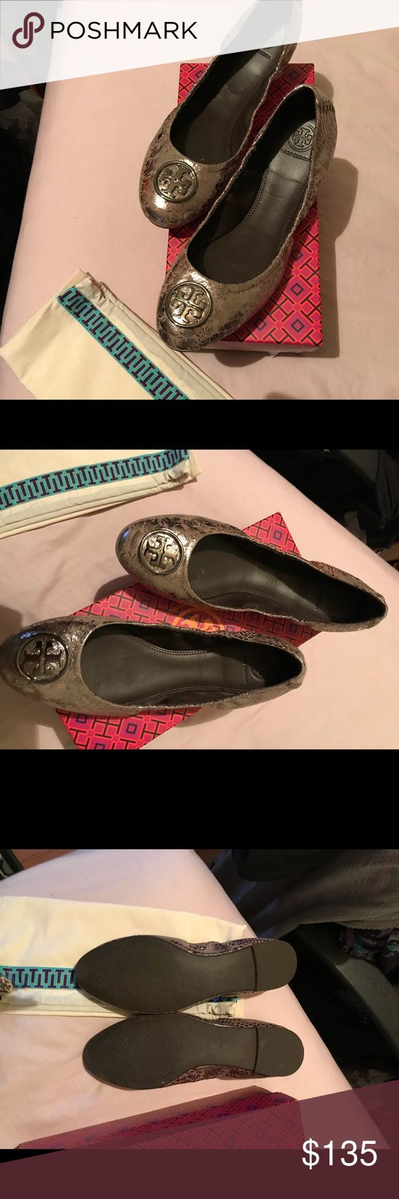 Brand new Tory Burch flats. Brand new Tory Burch flats. Tan and silver in a snake print.  Shoe has elastic around the edges for comfort and sitting around the foot. Bought at Nordstrom rack tags still on the box from shoes but not original box of shoes also comes with dust bag. Make A reasonable offer Tory Burch Shoes Flats & Loafers