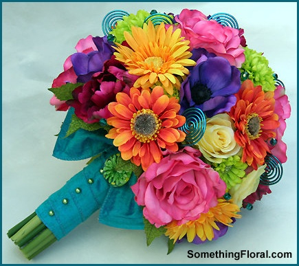 Realistic silk / artificial bridal bouquet of vibrantly colored roses, anemone, gerbera daisies, tulips, zinnia, chrysanthemums, dahlias, and decorative wire, finished with a teal, silk bow and green pearls.