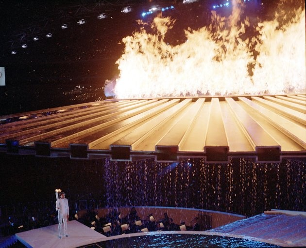 Olympic games faux pas   orch Bearer Cathy Freeman made a dramatic entrance for the Sydney 2000 Olympic Games Opening Ceremony. The sprinter lit a ring of fire in a pool and waited for a saucer-like contraption to rise above her. But it didn't. For four agonizing minutes, she smiled and waited. A computer glitch was finally fixed and the flame flew up to meet the cauldron. (Ben Elters\Getty Images)