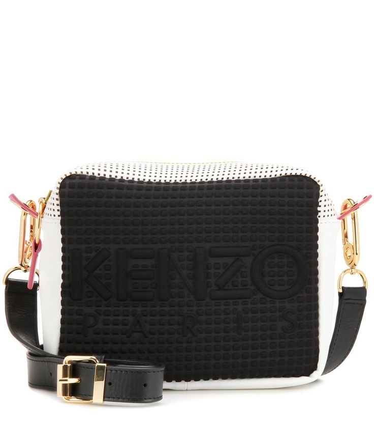 Kenzo - Kombo leather and fabric crossbody bag - Update your daytime bag edit with this camera-style Kombo bag from Kenzo. Embossed fabric at the front shows off the label's logo in a dimensional effect, while perforated and smooth white leather elevates the compact silhouette. Note the pops of pink and yellow which add playful character to the crossbody style. seen @ www.mytheresa.com