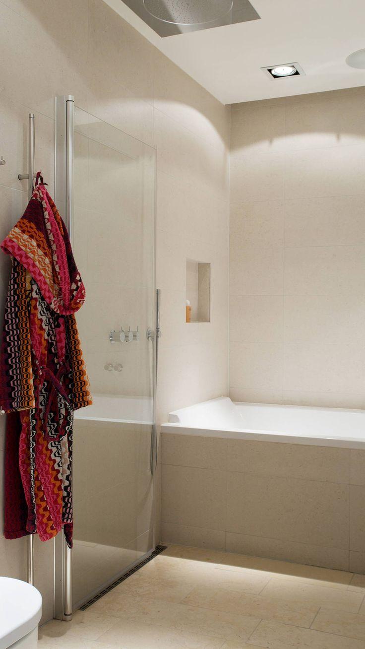 smart foldable shower door next to tub