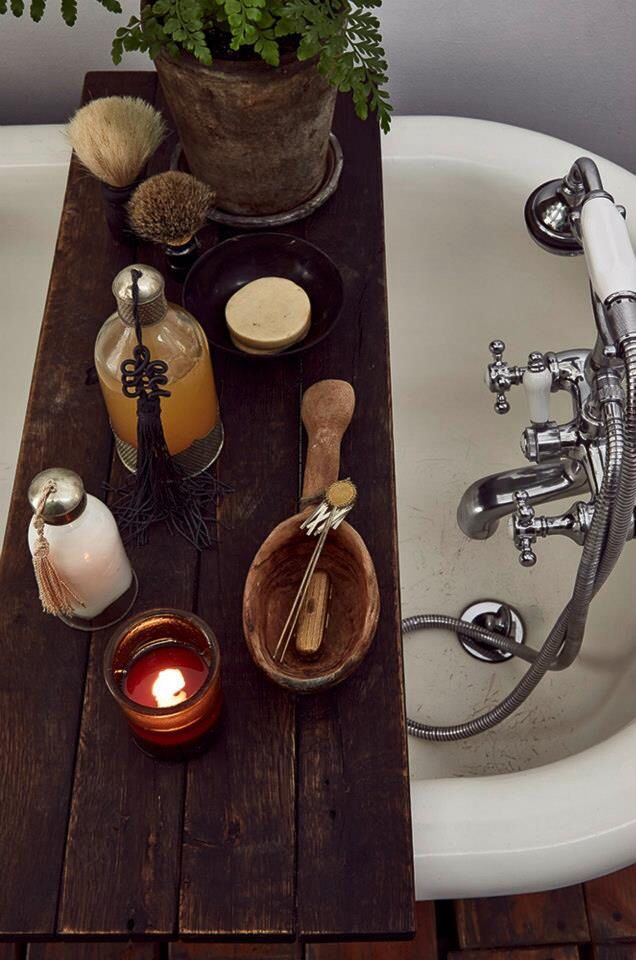 (Inspiration) Foamandbubbles.com: Use a rustic wooden plank over your bath to hold all your spa accessories.